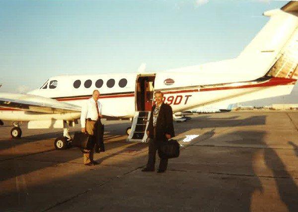 Man walking outside of plane