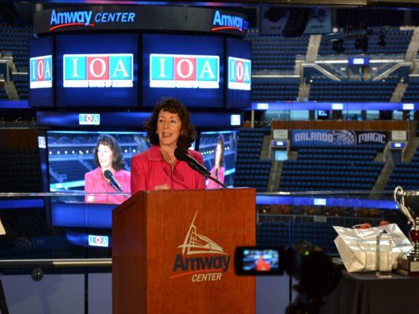 Valli Ritenour speaking at podium at Amway Center