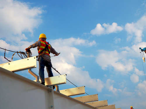 Construction Worker on top of roof