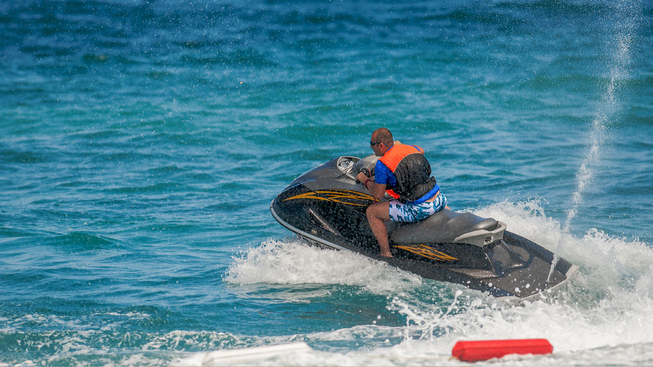 Man riding a jet ski in the water.