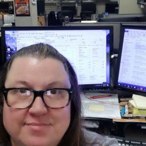 Deborah Moss at computer.