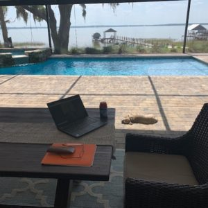 Work from home station by pool.